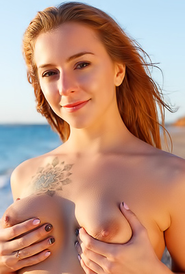 Elison Naughty Cutie masturbates on the beach
